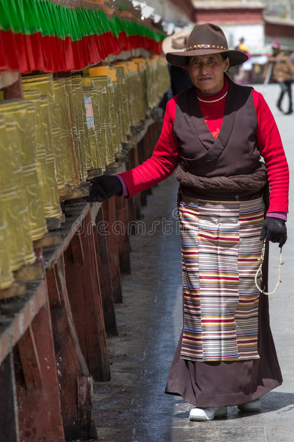 Tibetan pilgrim circles the Potala palace in Lhasa royalty free stock photos