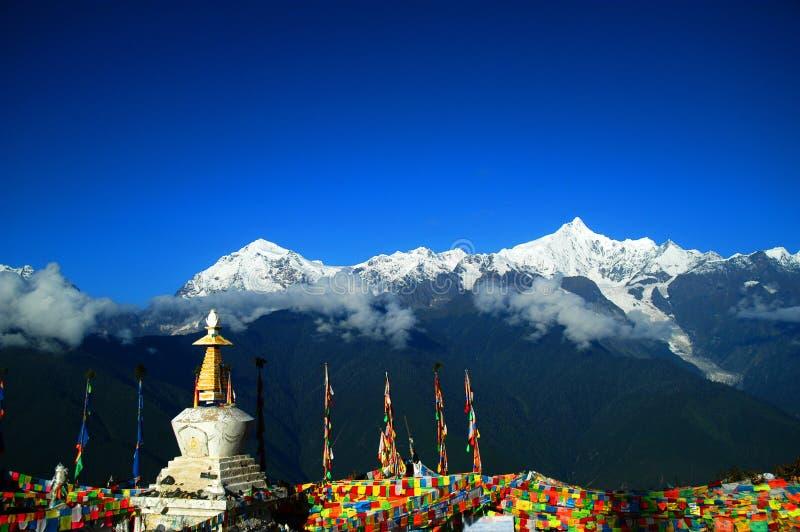 "Tibetan Pilgrimage Mountain. Mount Kawa Karpo. As one of the most important pilgrimage sites in Tibet, Kawakarpo (or ""Kagebo Peak"") tops the list of royalty free stock images"