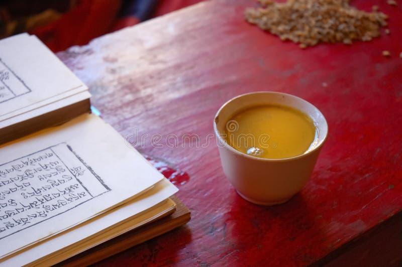 Tibetan prayer book and salt tea royalty free stock images