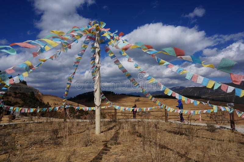 Tibetan Prayer Flags. Colorful rectangle Tibetan Prayer Flags hung over a top of a mountain on the way to Shangrila - a area near Tibet - China. The flags come stock images