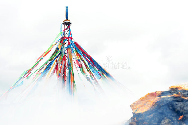 Tibetan prayer flags and mani rock stock photos