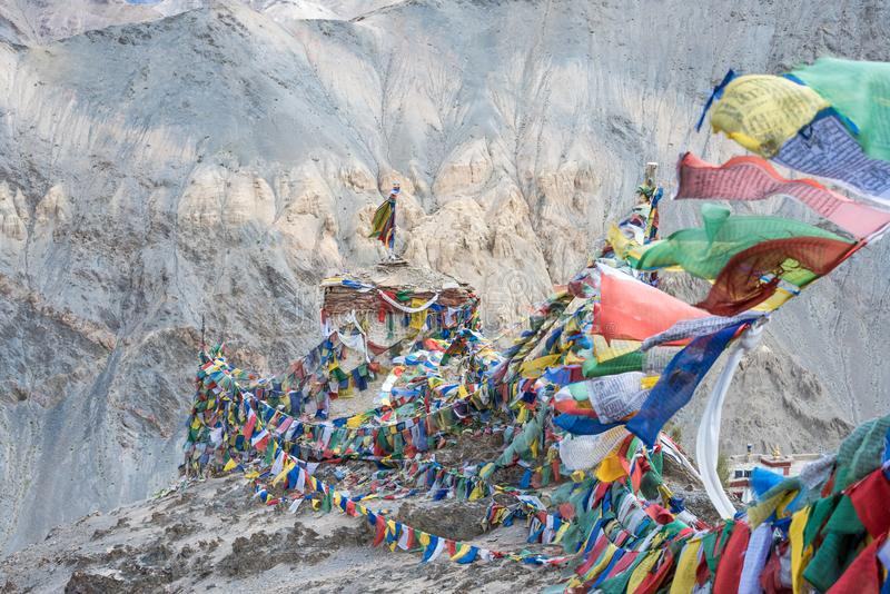 Tibetan prayer flags on mountain for cultural travel. stock image