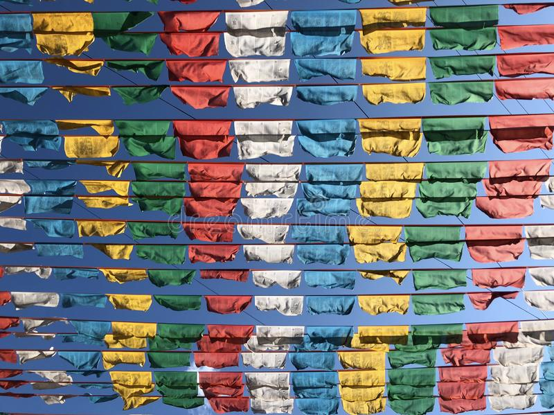 Tibetan prayer flags. Wind flying on the blue sky royalty free stock images