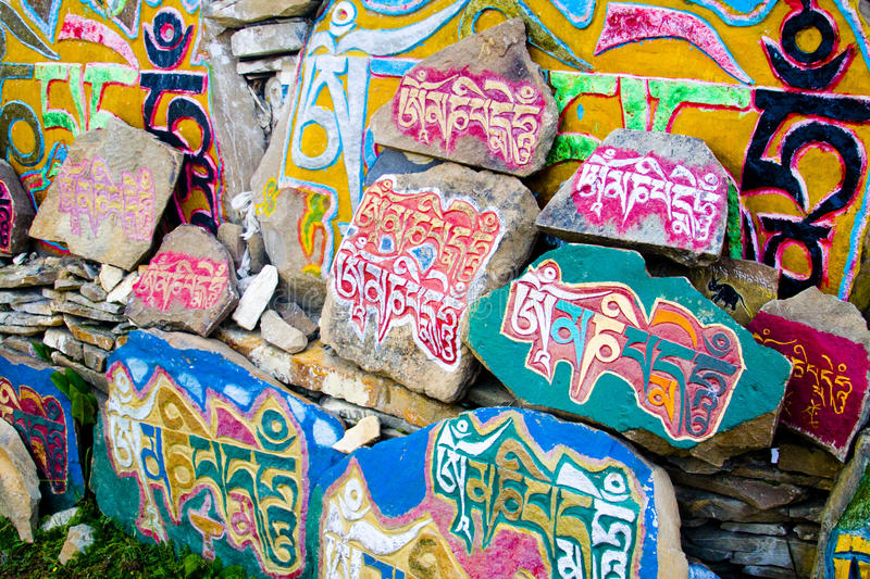 Tibetan prayer stones, religious Buddhist symbols royalty free stock photos