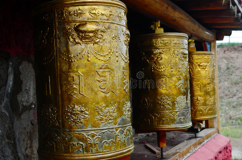 Tibetan prayer wheels stock images