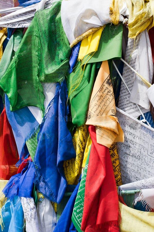 Tibetan praying flags. Lot of colorful Tibetan praying flags with written mantras stock photos