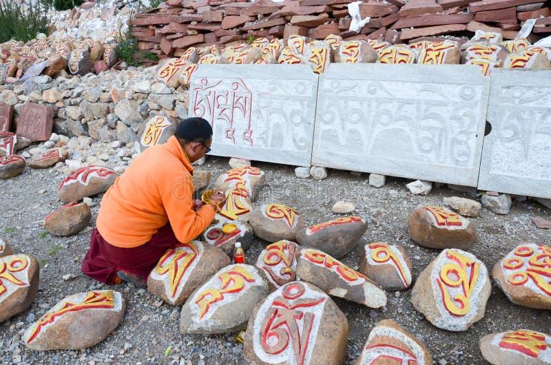 Tibetan rock painting artist stock photography