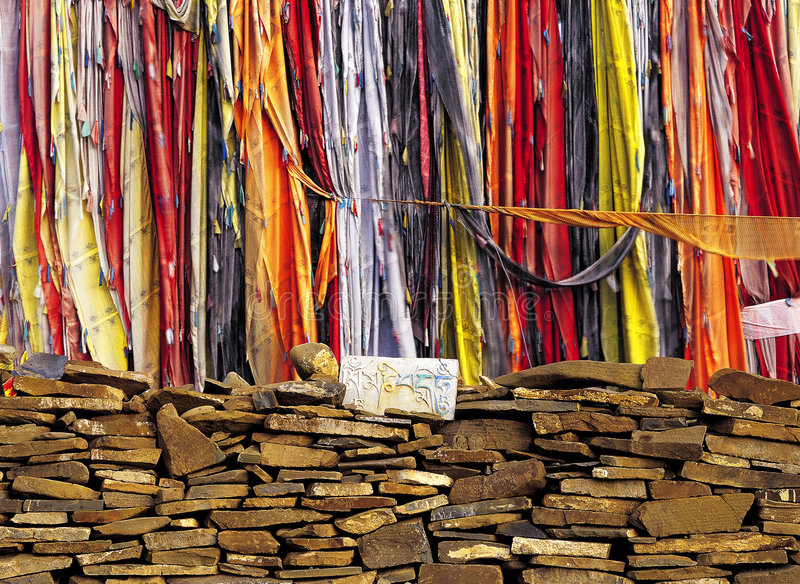 Tibetan's prayer flags and praying(mani) stones. Prayer flags are inscribed with auspicious symbols, invocations, prayers, and mantras. Tibetan Buddhists for royalty free stock image