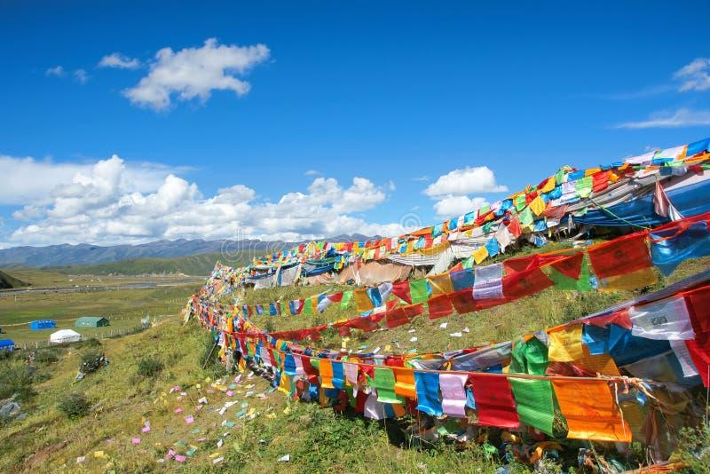 Tibetan scenery. The prayer flags are hung at Tibetan hillside stock photo