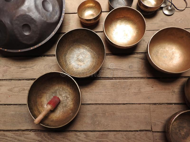 Tibetan singing bowl and other religious ritual instruments for meditation.  royalty free stock photography