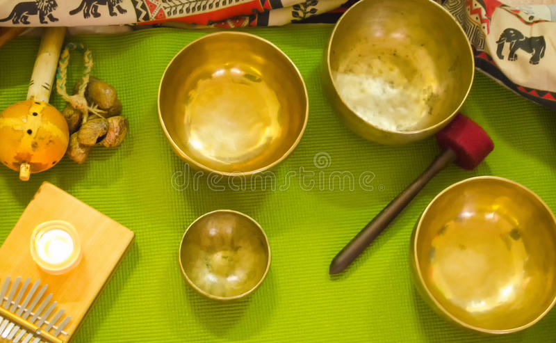 Tibetan singing bowls. Asian music instruments for relaxation and meditation. Accessories for sound massage. Tibetan singing bowls. View from above. Asian music royalty free stock photos