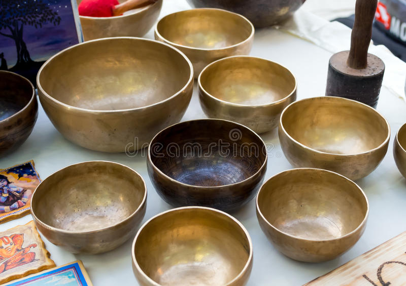 Tibetan Singing bowls are on the market counter stock photos