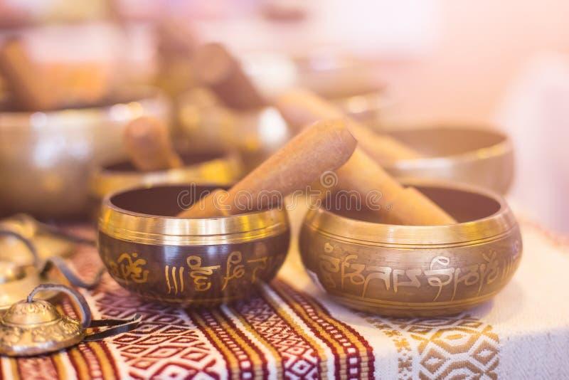 Tibetan singing bowls. Two tibetan singing bowls. Buddhism, yoga accessory stock image