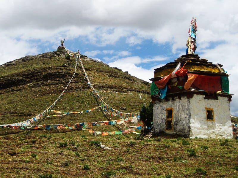 Tibetan Stupa At Hill Top With Prayer Flags stock photo
