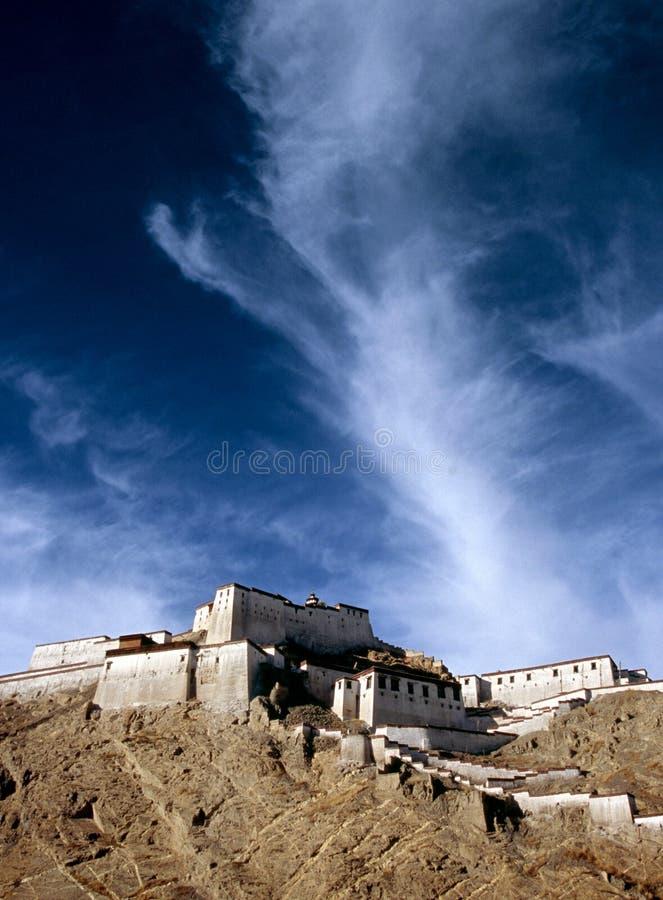 Tibetan Temple. Tibetan monastery, Gyantse Dzong, built high on a hill with deep blue sky behind stock photos