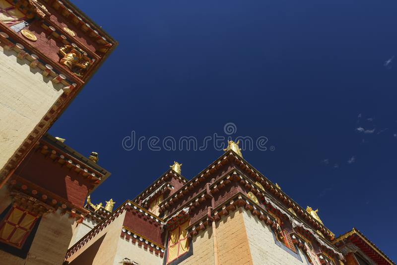 Tibetan temple closeup. With blue sky background at songzhanlin temple, shangri la, China. low view point royalty free stock image