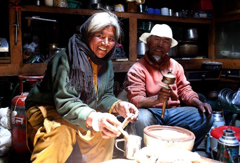 Tibetan woman cooking. stock photos