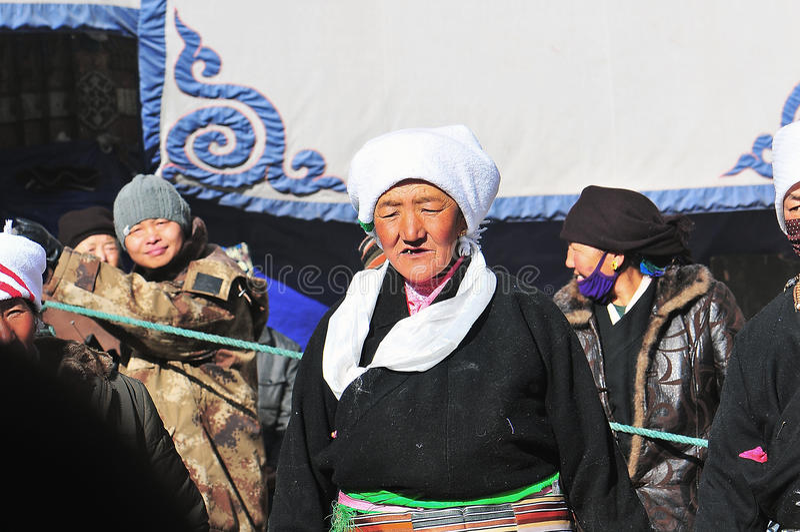 Tibetan woman. Pilgrims in the Jokhang Temple in Lhasa stock photo