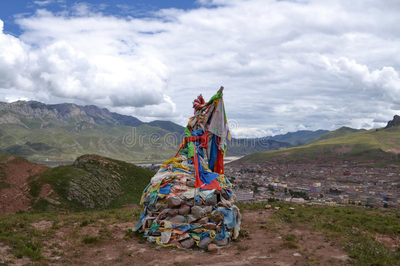 Tibetans prayer flags and praying(mani) stones. Prayer flags are inscribed with auspicious symbols, invocations, prayers, and mantras. Prayer flags are said to stock images