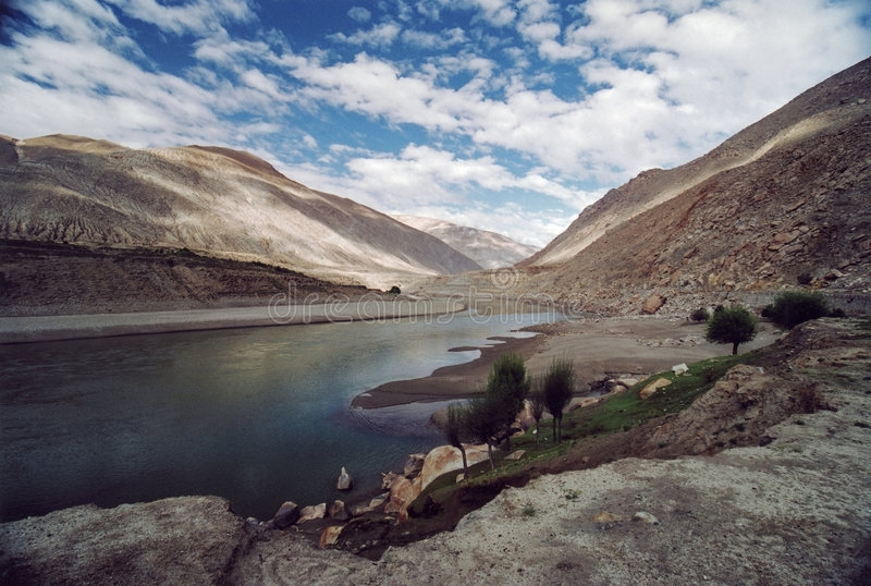 Tibetian landscape with clouds and river Brahmaputra stock photo