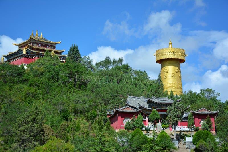 Tibetian temple and the biggest buddhist wheel, Shangri-La. Beautiful view of the Tibetian temple and the biggest buddhist wheel in the world. Shangri-La, Yunnan stock photography