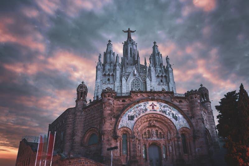 Spain Barcelona Tibidabo Cathedral Sunset. Tibidabo Hill barcelona sunset time Cathedral with Jesus Christus royalty free stock images