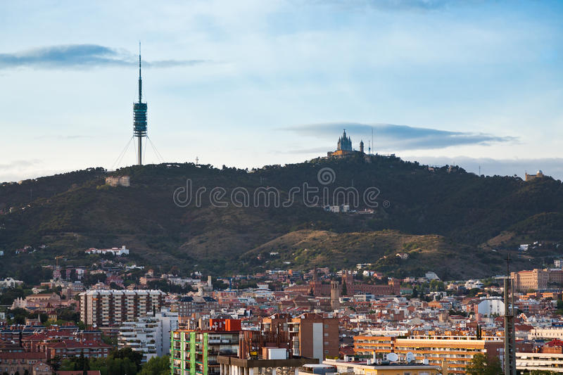 Tibidabo Mountain in Barcelona. Tibidabo Mountain with TV tower and Expiatory Church in Barcelona in evening stock images