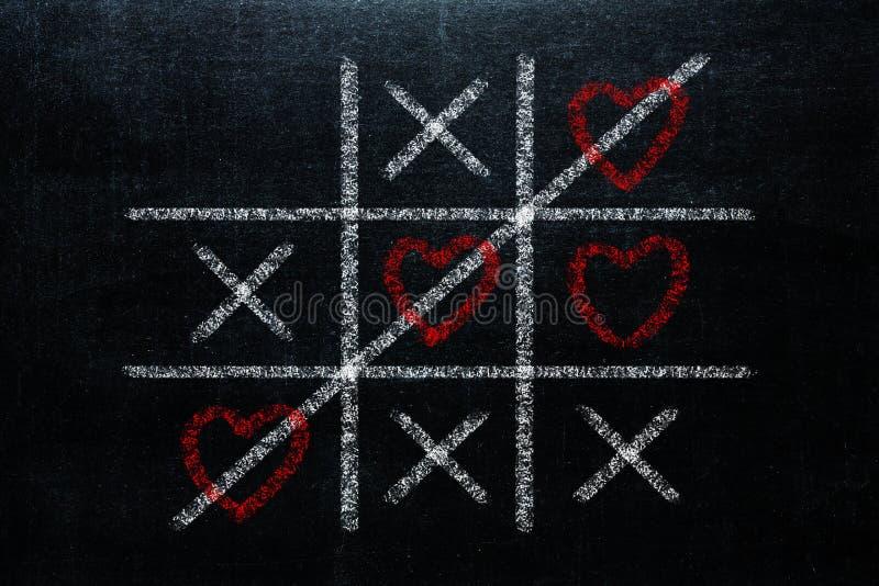 Tic abstrait Tac Toe Game Competition avec la forme de coeur dans le ce images libres de droits