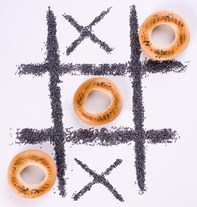 Tic-tac-teen met ongezuurde broodjes royalty-vrije stock foto