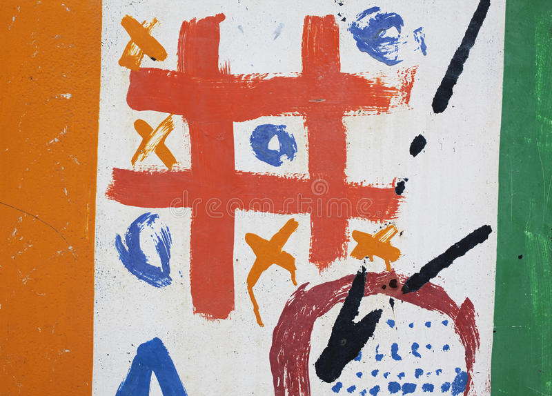 Tic-tac-toe game painted on wall stock photography
