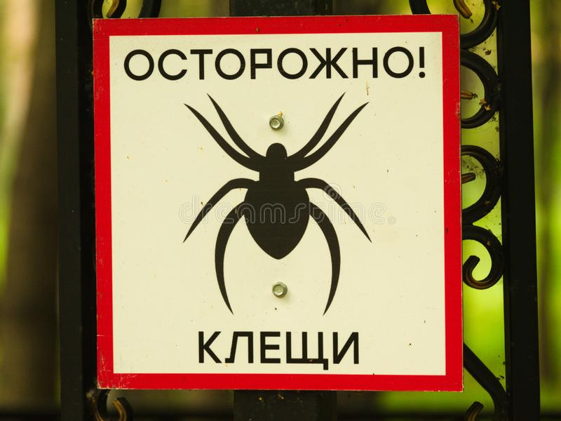Tick Sign. A tick warning sign with red frame, showing a tick royalty free stock photos