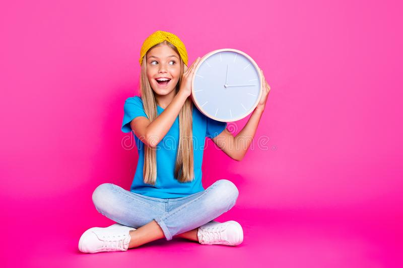 Tick tock. Portrait of funny funky kid hold clock listen to minutes seconds wait for her birthday party leisure holidays stock photos