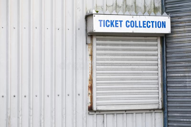 Ticket collection sign at box office counter by football sports event stadium stock photos