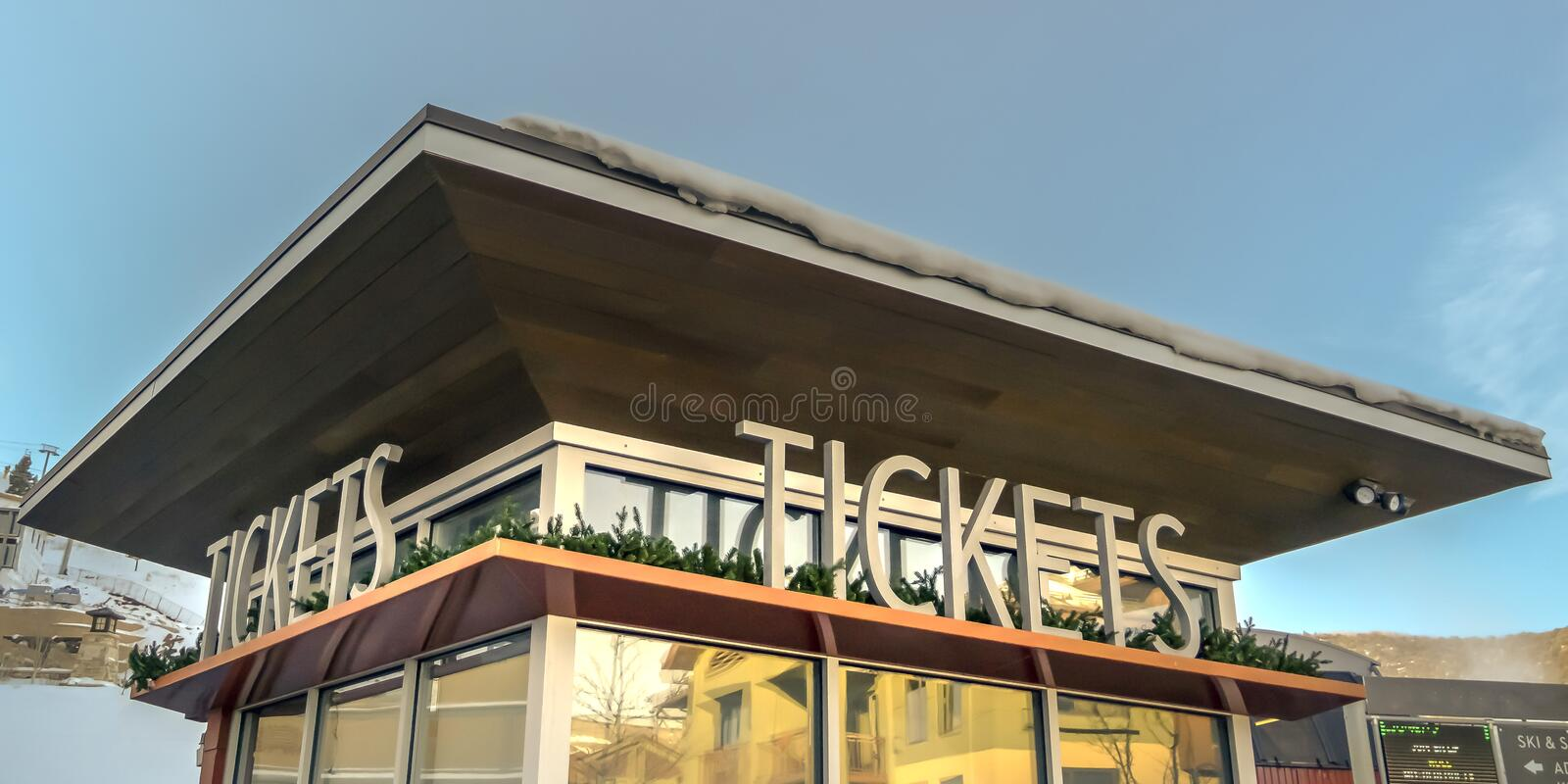 Ticket office with snow covered roof in winter royalty free stock photography