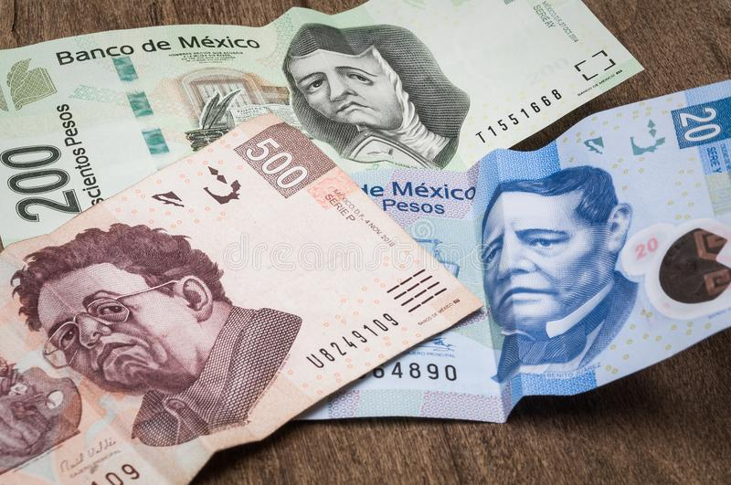 Tickets of 20, 200 and 500 mexican pesos seem to be sad. stock photos