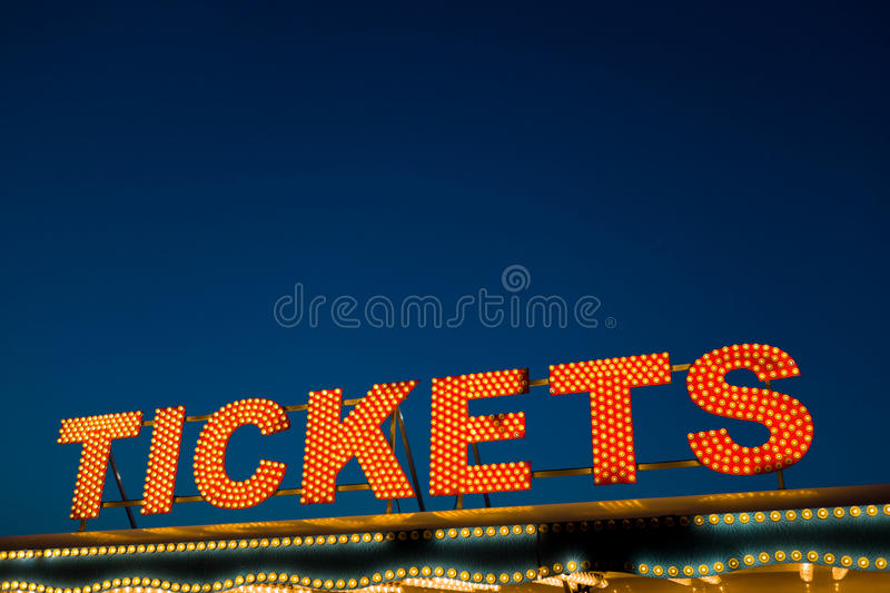 Tickets Sign. By night royalty free stock photos