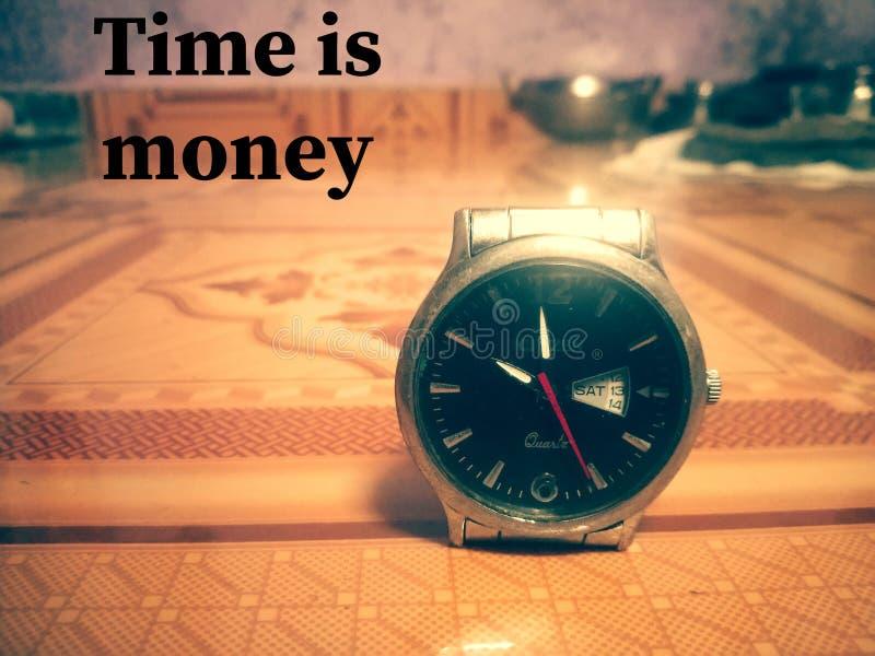 Tid är pengartapeten royaltyfri fotografi