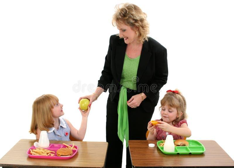 tid för äpplelunchlärare arkivbild