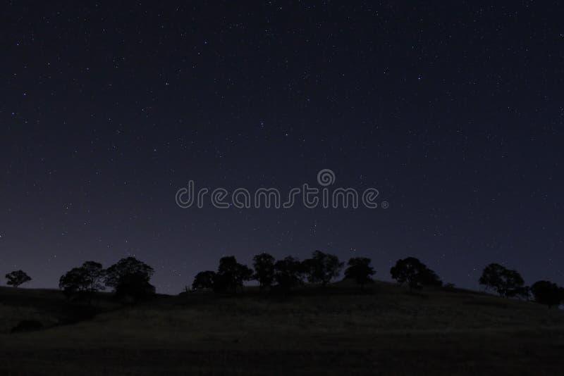 tid för stjärnor för nattsky royaltyfri foto