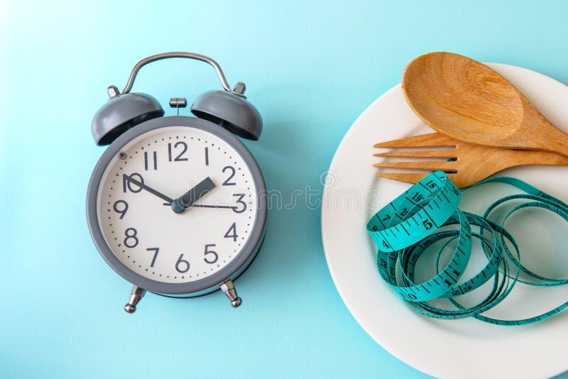 Tid som förlorar vikt och att äta kontroll eller tid för att banta begrepp, a arkivfoton