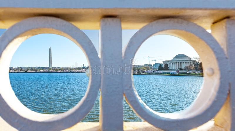 Tidal Basin with the Washington Monument and Jefferson Memorial as viewed through the Hole of the Inlet Bridge on Ohio Drive, royalty free stock photography