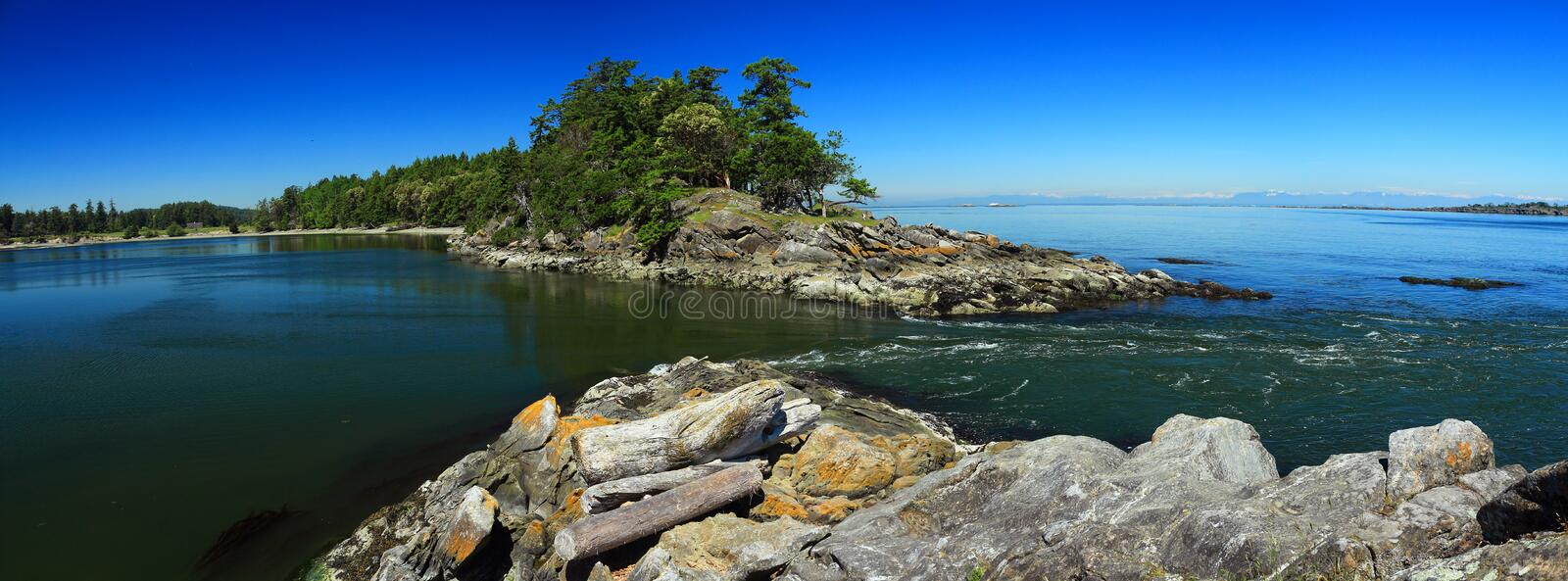 Panorama of Tidal Current at Boat Pass between Samuel and Saturna Islands, Gulf Islands National Park, British Columbia, Canada royalty free stock photo