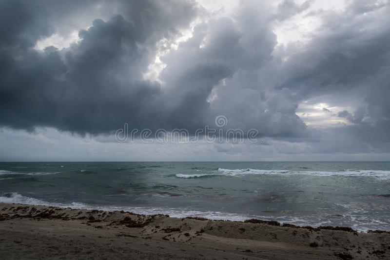 Tidal waves hitting Miami Beach shore on cloudy day royalty free stock photos