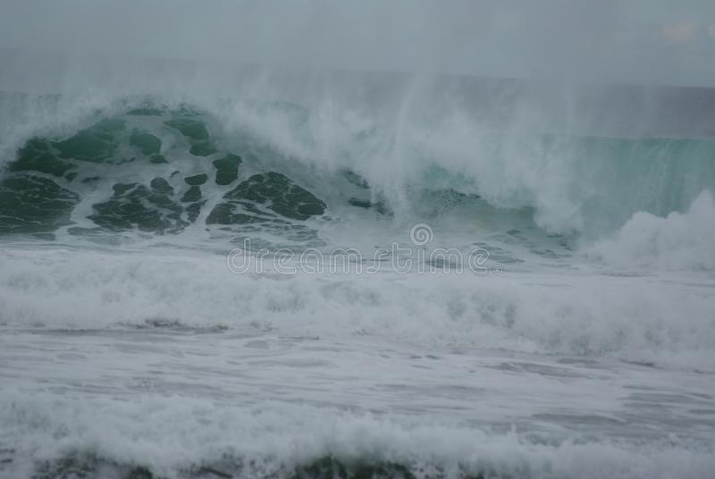 High Tide in Rough Seas. The tide is high and the seas are very rough. It is too dangerous to go out in a boat for fishing or to go swimming in these waves royalty free stock photo
