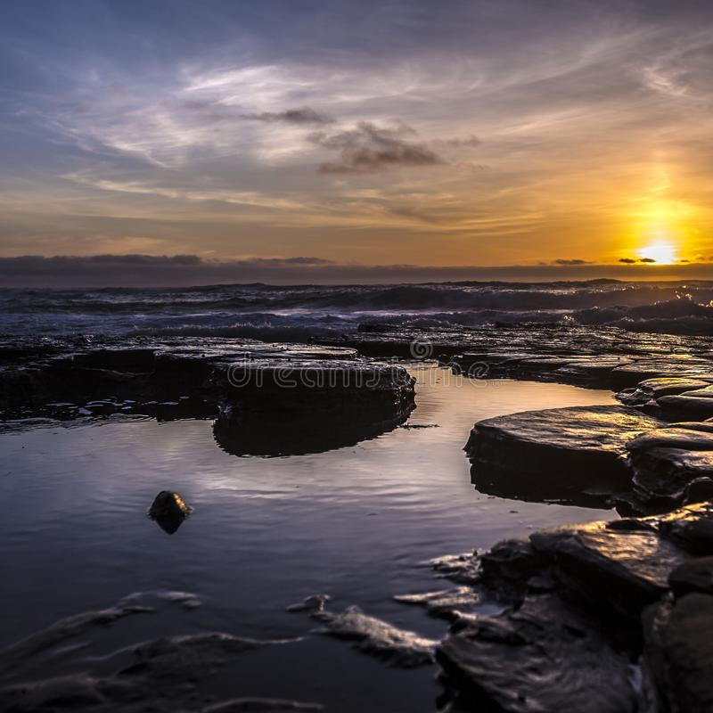 Free Tide Pools With A Dramatic Sunset In San Diego Stock Photography - 130173912