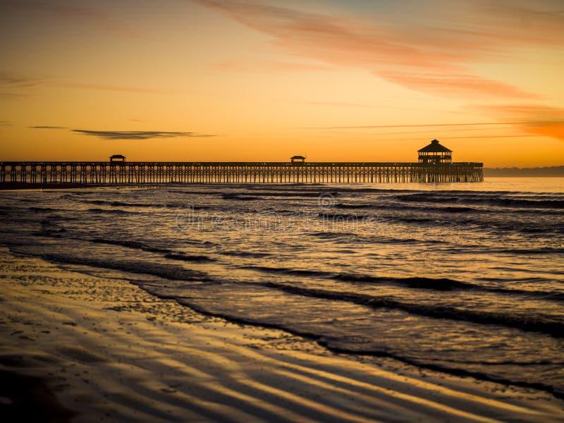 Tidig soluppgång över Atlanten arkivfoto