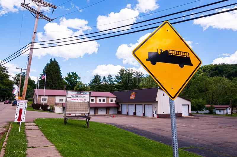 Tidioute, Pennsylvania, USA 6/21/2019 The Tidioute Volunteer Fire Department on Main Street with a firetruck sign. Under bright blue skies royalty free stock photos