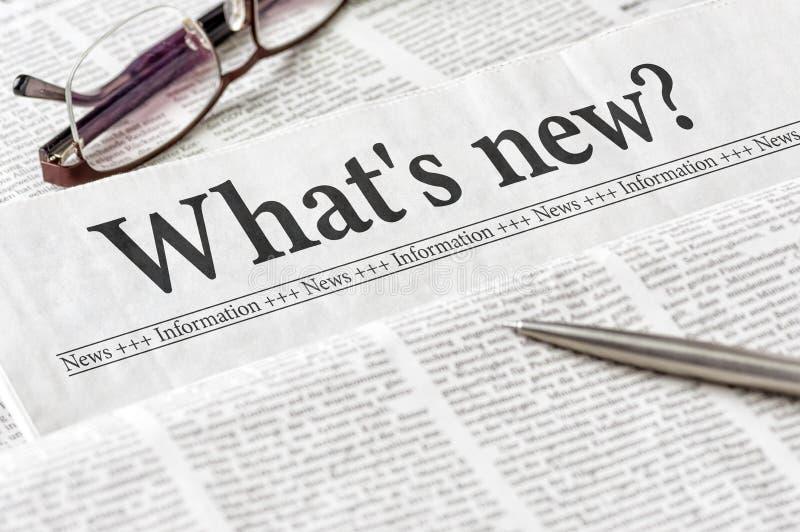 Tidning med rubriken vad är ny royaltyfria foton