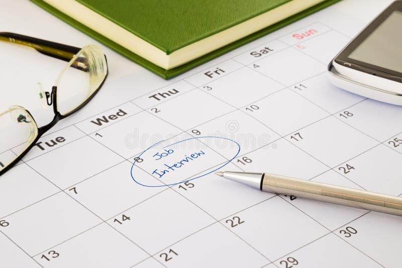 Tidsbeställning för jobbintervju på schema royaltyfri fotografi