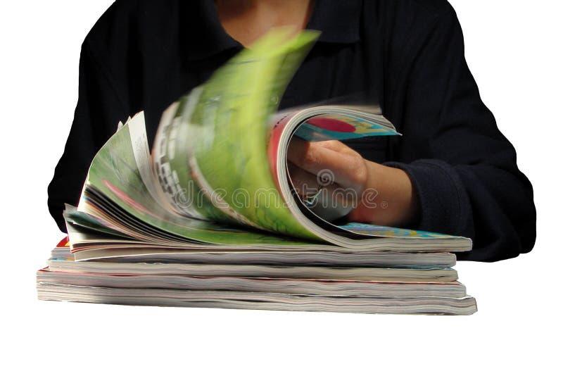 tidskrifter som riffling royaltyfri foto